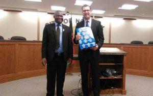 Blantyre City Wild Ndipo on the left to welcome Norfolk City Mayor Josh Moenning
